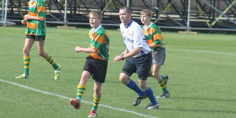 First Aid Instructor Aidan Woodward saved a life while refereeing a rugby game.