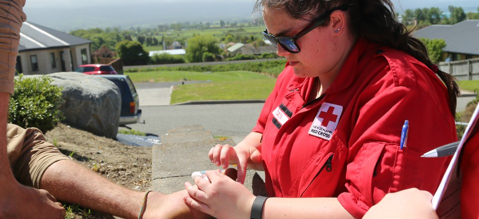 Dunedin DWST member Tayla performs first aid during an outreach visit in Kaikoura
