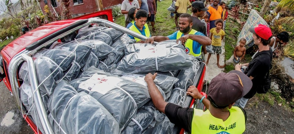 Unloading aid packages in Fiji during Tropical Cyclone Winston