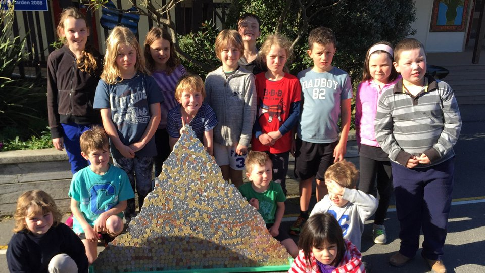 Houghton Bay School pupils show off the mountain of coins they raised for Nepal