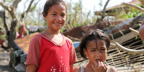 These children in Tonga are sleeping in a tent after their home was destroyed by Cyclone Gita.