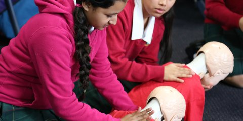 Students practise first aid skills at a Red Cross and Plunket babysitting course.