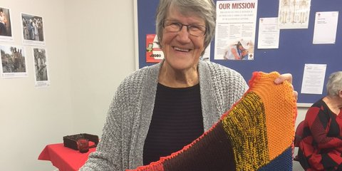 Jan Codwell with a blanket knitted by Dorothy, a 103 year old volunteer.