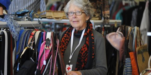 A woman in a Red Cross shop