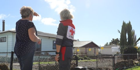 DWST member Nicky supports an Edgecumbe resident during the flood response.