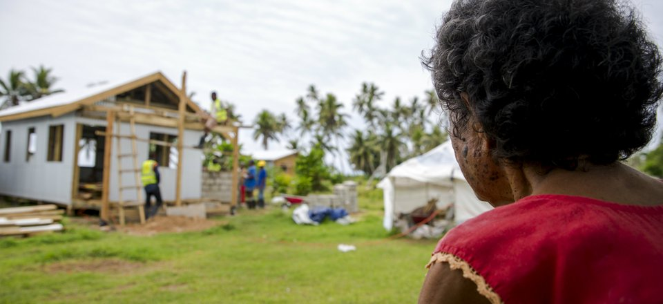 Makarita Racani looks at the house Red Cross is building for her