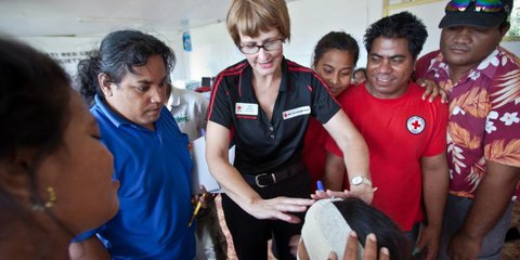 An instructor teaches First Aid in the Pacific