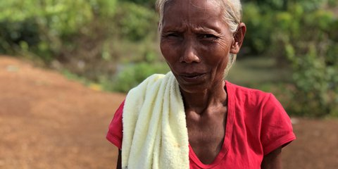 Si (55) saved herself but lost everything else, including a tractor she bought with a USD3,000 loan
