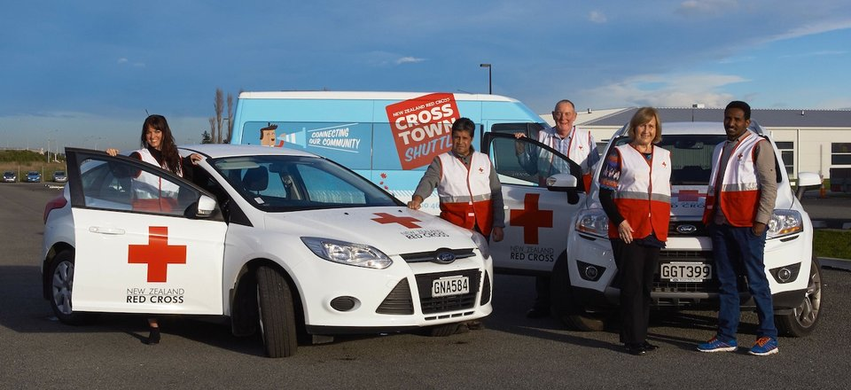 Volunteers with Red Cross vehicles