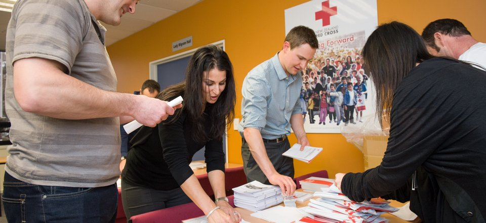 Employees volunteer their time to help out Red Cross
