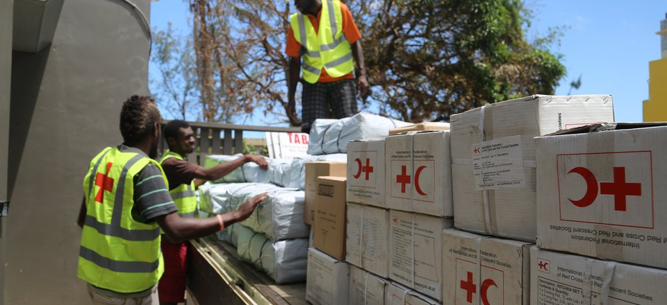 Red Cross unloads relief supplies to help cyclone-hit communities.