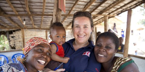Aid worker with children