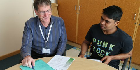 Pathways to Employment client Thass meets with team leader Alan