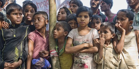 Children wait at a Red Cross Red Crescent distribution of relief items in the Balukhali camp for people who have fled violence in Myanmar.