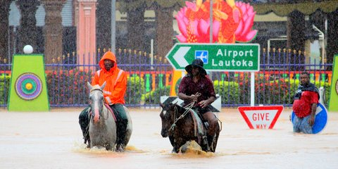 Fiji flooding - men on horseback